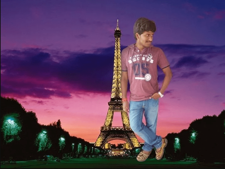 Merging his photo with Eiffel tower with his body in the same big size as the tower
